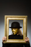 The woman with mask in funny concept Royalty Free Stock Photo