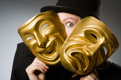 The woman with mask in funny concept. Woman with mask in funny concept Stock Photo