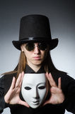 The woman with mask in funny concept. Woman with mask in funny concept Stock Photos