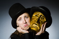 Woman with mask in funny concept Royalty Free Stock Photo