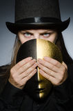 Woman with mask in funny concept Stock Photography