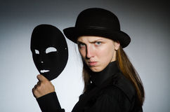Woman with mask in funny concept Stock Photos