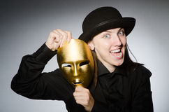 Woman with mask in funny concept Royalty Free Stock Image