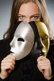 Woman with mask in funny concept Stock Image