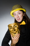 The woman with mask in funny concept Stock Photos