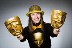 The woman with mask in funny concept Stock Images