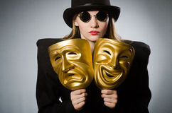 The woman with mask in funny concept Stock Photography