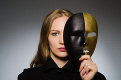 The woman with mask in funny concept Royalty Free Stock Images