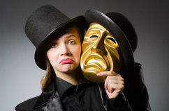 Woman with mask in funny concept Stock Images
