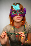 Woman in mask with garland. On grey Stock Photography