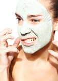 Woman in the mask with green clay Stock Photos