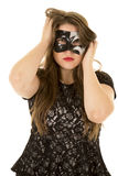 Woman mask hands hair serious Royalty Free Stock Image