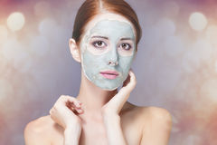 Woman with mask on her face Stock Images