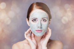 Woman with mask on her face Stock Photo