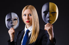 Woman with mask. In hypocrisy concept Stock Image