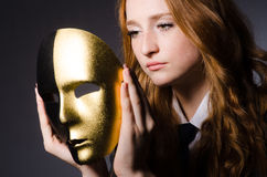 Woman with mask. In hypocrisy concept Royalty Free Stock Image