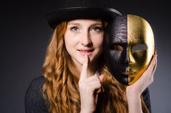 Woman with mask. In hypocrisy concept Royalty Free Stock Photo