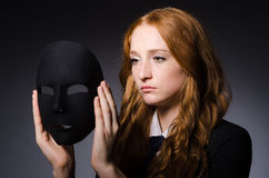 Woman with mask. In hypocrisy concept Stock Photos