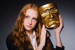 Woman with mask. In hypocrisy concept Stock Photography
