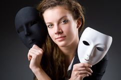 Woman with the mask in hypocrisy concept. Woman with mask in hypocrisy concept Royalty Free Stock Image