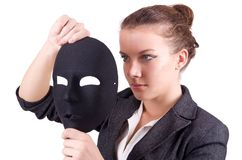 Woman with the mask in hypocrisy concept Stock Photo