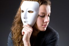 Woman with the mask in hypocrisy concept Royalty Free Stock Image