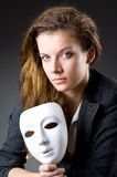 Woman with the mask in hypocrisy concept. Woman with mask in hypocrisy concept Stock Image
