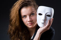 Woman with mask in hypocrisy concept Stock Images