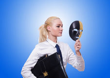 Woman with mask in hypocrisy concept Stock Photography