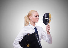 Woman with mask in hypocrisy concept Stock Photos