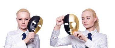 The woman with mask in hypocrisy concept. Woman with mask in hypocrisy concept Stock Photography
