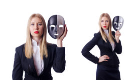 The woman with mask in hypocrisy concept. Woman with mask in hypocrisy concept Royalty Free Stock Images