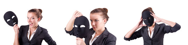 The woman with mask in hypocrisy concept. Woman with mask in hypocrisy concept Stock Images