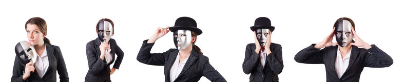 The woman with mask in hypocrisy concept. Woman with mask in hypocrisy concept Royalty Free Stock Image