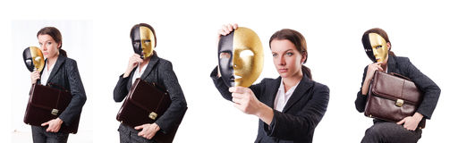 The woman with mask in hypocrisy concept. Woman with mask in hypocrisy concept Stock Photo