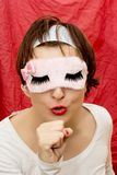 Woman in mask imitates singing into a microphone royalty free stock image