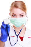 Woman in mask and lab coat. Doctor nurse with stethoscope. Royalty Free Stock Photo