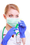 Woman in mask and lab coat. Doctor nurse with syringe. Royalty Free Stock Photos