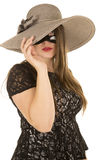 Woman mask one eye under hat Royalty Free Stock Photography
