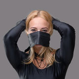 Woman with mask over her mouth Stock Photography