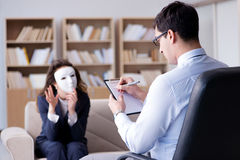The woman with mask during psychologist visit Stock Photo