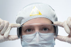 Woman in mask and rubber gloves Royalty Free Stock Photo