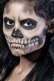 Woman with mask skull. Halloween face art. Young woman in day of the dead mask skull face art. Halloween face art with fog on black background Royalty Free Stock Photography