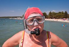 Woman with a mask and snorkel Stock Images
