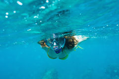 Woman with mask snorkeling Royalty Free Stock Image