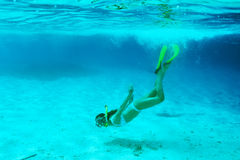 Woman with mask snorkeling Stock Photos