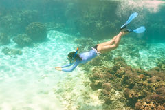 Woman with mask snorkeling Stock Images