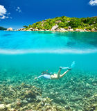 Woman with mask snorkeling in clear water. At Seychelles Stock Photos