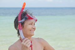 Woman with a mask for snorkeling Royalty Free Stock Photo