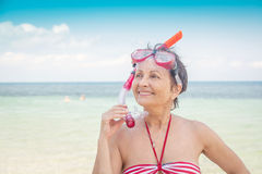 Woman with a mask for snorkeling Stock Photography
